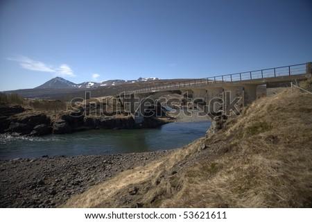 old bridge crossing river in Iceland - stock photo