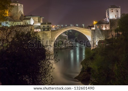 Old bridge in Mostar by night - stock photo