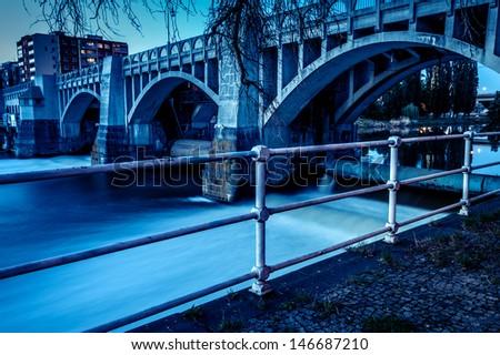 Old bridge over Elbe river in Kolin, Czech Republic  - stock photo