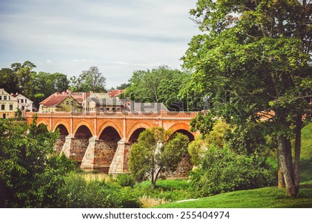 Old bridge over the river - stock photo
