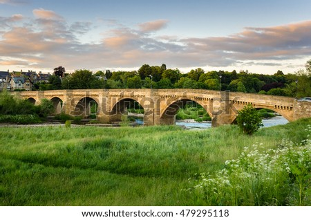 Old Bridge over the River Tyne at Sunset. Corbridge, England,
