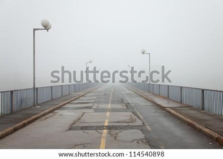 old bridge with fog - stock photo