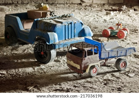 Old, broken, abandoned children's toys in the attic - stock photo