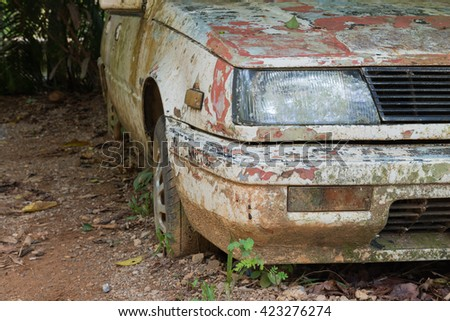 old broken car front view - stock photo