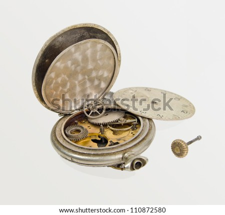 old broken clock parts, on a gray background - stock photo