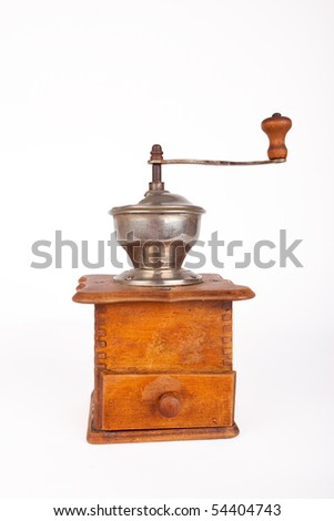 Old broken coffee mill on white background
