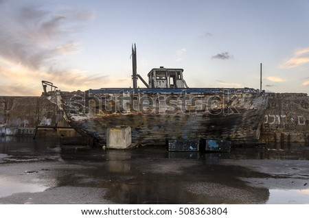Old broken fishing ship wreck. Side view