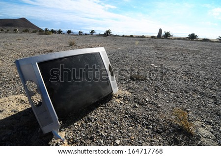Old Broken Gray Television Abandoned in the Desert