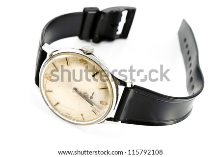 Old broken wristwatch with black strap isolated on white - stock photo