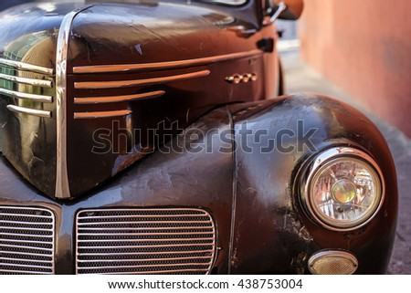 Old Brown American car segment of the car - stock photo
