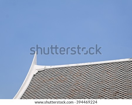 Old brown brick roof Asia style with blue sky background and copy space.