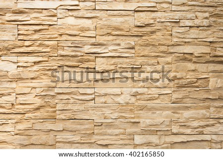Old brown bricks wall pattern and background - stock photo