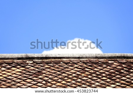old brown clay roof tiles with sky and cloud background,select focus with depth of field:ideal use for background