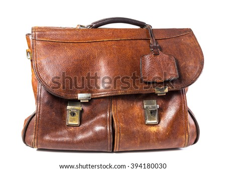 Old brown leather briefcase isolated on white background - stock photo