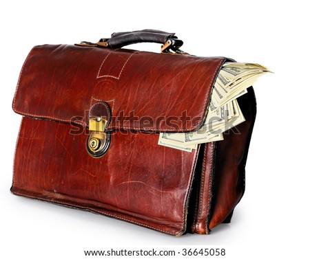 old brown leather briefcase of a businessman full with dollar banknotes