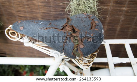 old brown leather of bike seat - stock photo