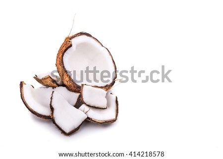 Old brown organic coconut fruit copra broken into pieces on white background - stock photo