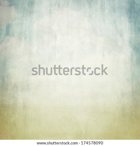 old brown paper background texture and blue sky view - stock photo