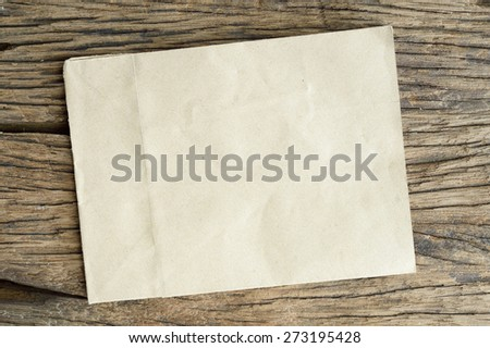 old brown paper on wooden background