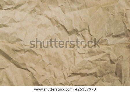 Old brown paper texture with crumpled paper background