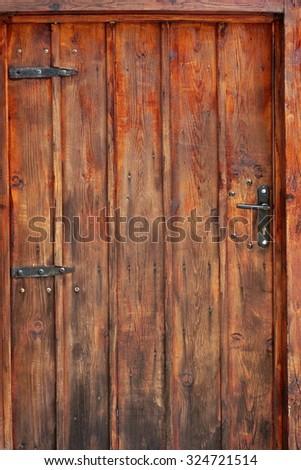 Old Brown Planked Wood Door Background Texture - stock photo
