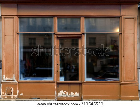 Old brown shop in Paris with lots of copy space - stock photo