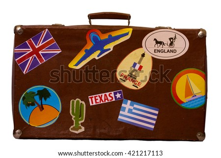 old brown suitcase with labels front view. On white background