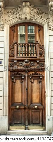 Old Brown wooden Door in Paris, France - stock photo