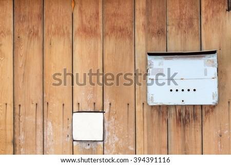 Old Brown Wooden Door With Mailbox Hanging