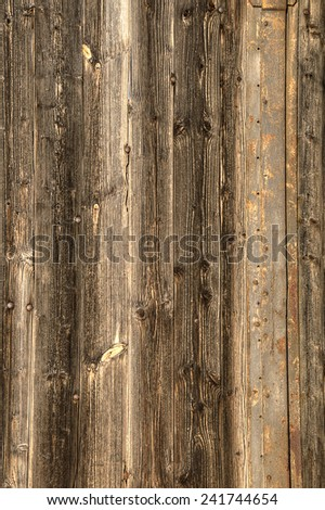 Old brown wooden wall. Vertically upright - stock photo