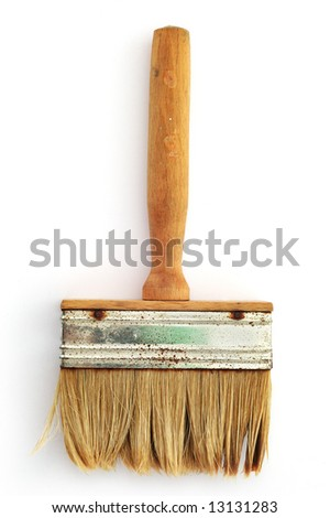 Old brush with wooden hand on the white background.