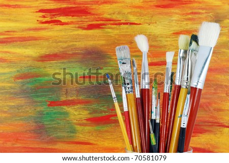 Old brushes on a background