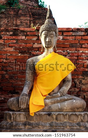 old buddha statue in a temple in ayutthay - stock photo