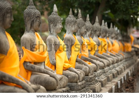 old Buddha statue in temple at Wat Yai Chai Mongkol at Ayutthaya, Thailand. World Heritage Site - stock photo