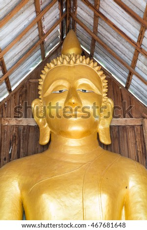 old buddha statue under the roof