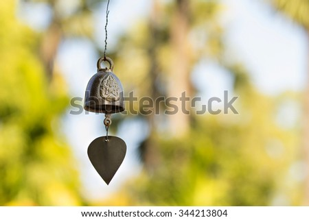 Old buddhist brass bell against defocused background - stock photo