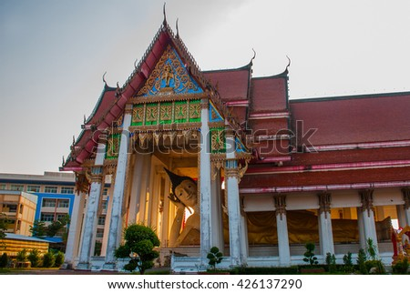 Old Buddhist temple in the city Hatyai. A huge reclining Buddha. Thailand. - stock photo