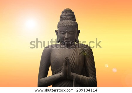 Old Budha - statue in Asia - sunset effect - stock photo