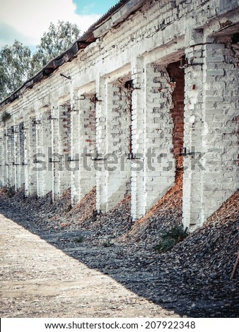 Old building - a warehouse of white brick - stock photo