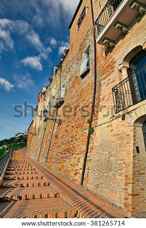 old building and flight of stairs in the mediterranean town Vasto, Abruzzo, Italy - stock photo