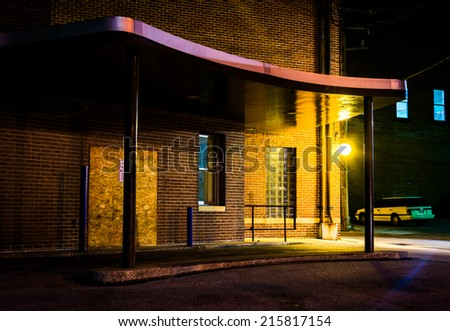 Old building and parked car in Hanover, Pennsylvania at night. - stock photo