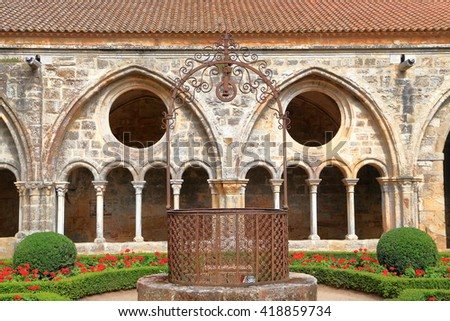 Old building and patio of the cloister of Fontfroide Abbey, Languedoc-Roussillon, France - stock photo