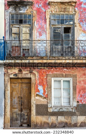 Old building facade in Olhao, Algarve, Portugal, Europe - stock photo