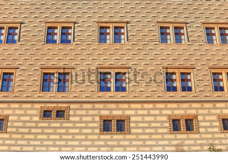 Old building facade painted with brick pattern in Lesser Town, Prague, Czech Republic - stock photo