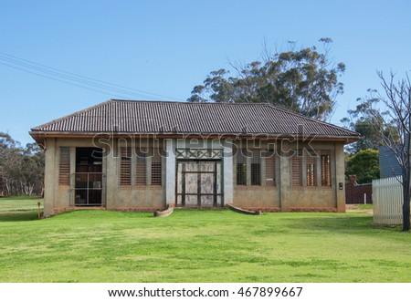 Old building in New Norcia, Western Australia with rustic features under a blue sky/Historic New Norcia/NEW NORCIA,WA,AUSTRALIA-JULY 15,2016: Old rustic building in New Norcia, Western Australia.