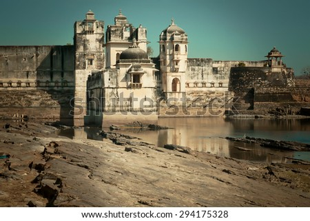 Old building of Padmini's palace with towers and sandstone walls in area of the Chittorgarh Fort. It is an UNESCO World Heritage Site under the group Hill Forts of Rajasthan, India. - stock photo