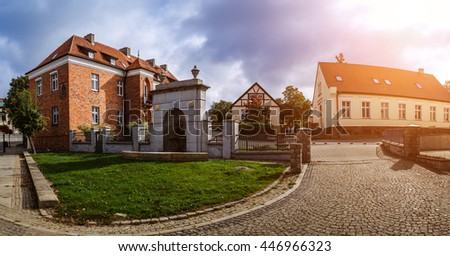 Old building of red brick. Gniezno, is a city located in northern Poland, on the Brda and Vistula rivers.