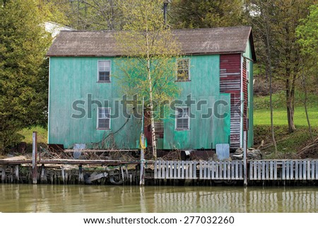 Old building on the river - stock photo