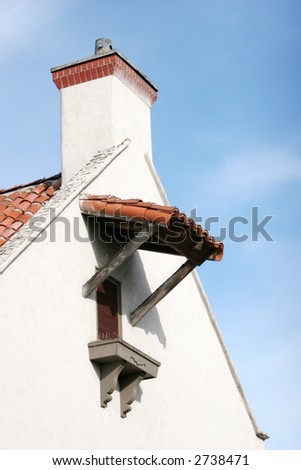 Old building window, roof and chimney