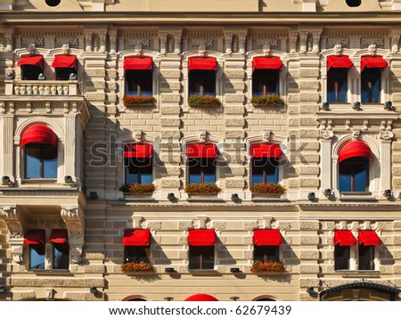 old building with decorated windows at street of fiver Mojka,  St. Petersburg - stock photo